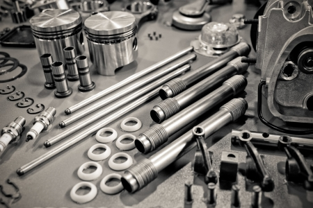 collection of precision auto engine parts laid out in a workshop