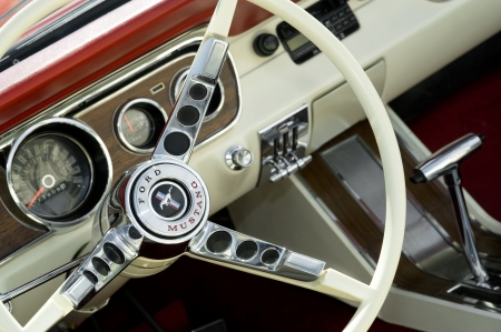 Farnborough, United Kingdom - April 22, 2011: Iconic Ford Mustang muscle car interior on display at the annual Wheels Day motor show, Farnborough, UK.