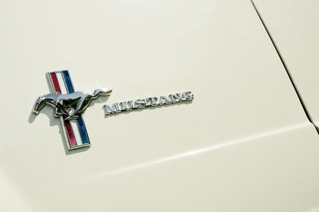 Farnborough, UK - APRIL 22, 2011: Iconic Ford Mustang badge on a cream vehicle panel at the annual Wheels Day auto show. Farnborough, UK. Editorial