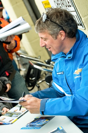 reigning: Thruxton, United Kingdom - May 1, 2011: Jason Plato, reigning British Touring Car champion driver signing autographs before racing at the Thruxton circuit. Editorial