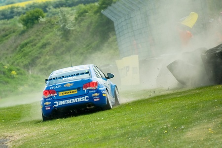 reigning: Thruxton, United Kingdom - May 1, 2011: Jason Plato, reigning British Touring Car champion hitting the barrier while racing at the Thruxton circuit.