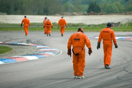 btcc: Thruxton, United Kingdom - May 1, 2011: Track safety marshalls inspect the circuit for debris between races at the Thruxton, British Touring Car Championship race meeting, UK. Editorial