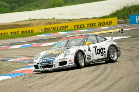 carrera: Thruxton, United Kingdom - May 1, 2011: Opposite lock for driver Steve Parish in a Porsche Carrera Cup race meeting at the Thruxton circuit, UK.