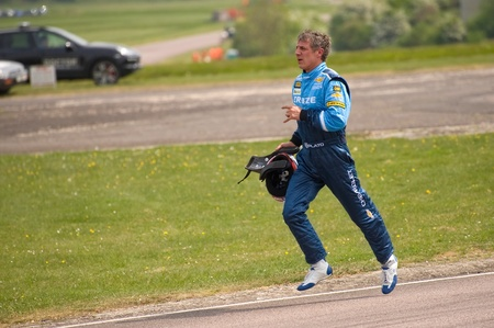 toca: Thruxton, United Kingdom - May 1, 2011: Jason Plato, reigning British Touring Car champion running back to the pits after crashing in a race at Thruxton, UK.