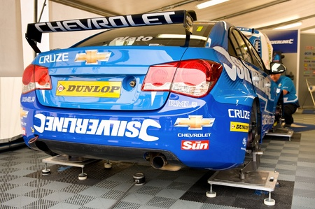 Thruxton, United Kingdom - MAY 1, 2011: Silverline Chevrolet Cruze driven by Jason Plato undergoing maintenance before racing in the British Touring Car Championship at Thruxton, UK Stock Photo - 9444797