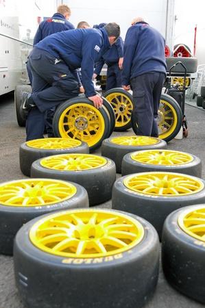 slick: Thruxton, United Kingdom - MAY 1, 2011: Pirtek pit crew making tire choices before racing in the British Touring Car Championships at Thruxton, UK