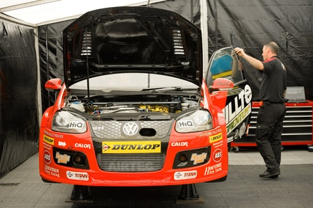 Thruxton, United Kingdom - MAY 1, 2011: Milltek Sport VW Golf driven by Tom Onslow-Cole being inspected before racing in the British Touring Car Championships at Thruxton, UK. Stock Photo - 9444798