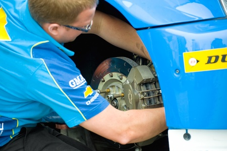 toca: Thruxton, United Kingdom - May 1, 2011: Silverline team mechanic working on the Chevrolet Cruze driven by Alex MacDowall at the British Touring Car Championship meeting, Thruxton, UK