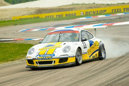 Thruxton, United Kingdom - May 1, 2011: George Brewster blows a tire during a Porsche Carrera Cup race at Thruxton, UK
