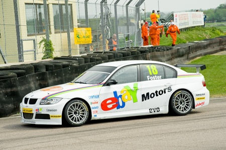 toca: Thruxton, United Kingdom - May 1, 2011: West Surrey Racing Team BMW driven by Nick Foster at the British Touring Car Championship in Thruxton, UK Editorial