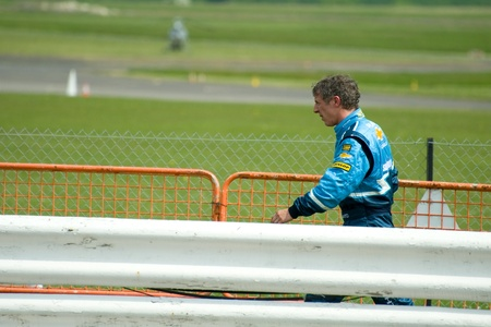 toca: Thruxton, United Kingdom - May 1, 2011: Jason Plato, reigning British Touring Car champion returning to the pits after crashing during the championship meeting at Thruxton, UK Editorial