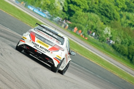 toca: Thruxton, United Kingdom - May 1, 2011: Gordon Shedden in his Honda Racing Civic turbo heading for victory in the British Touring Car Championship at Thruxton, UK