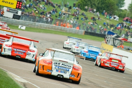 Thruxton, United Kingdom - May 1, 2011: Race cars on the starting grid for a Porsche Carrera Cup race at Thruxton, UK