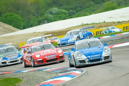 Thruxton, United Kingdom - May 1, 2011: James Sutton leading the field to victory in a Porsche Carrera Cup race meeting at Thruxton, UK Stock Photo - 9472274