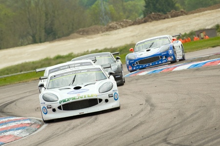 Thruxton, United Kingdom - May 1, 2011: Ginetta sports cars through the chicane during racing at Thruxton, UK Stock Photo - 9475651