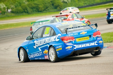 toca: Thruxton, United Kingdom - May 1, 2011: Alex MacDowell lifts a wheel while cornering his Silverline Chevrolet Cruze at the British Touring Car Championships, Thruxton, UK
