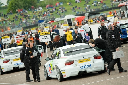 british touring car: Thruxton, United Kingdom - May 1, 2011: Hectic starting grid activity before a British Touring Car Championship race meeting in Thruxton, UK