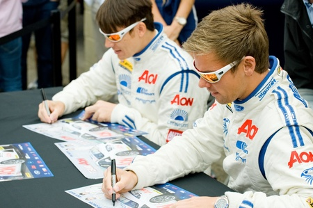 btcc: Thruxton, United Kingdom - May 1, 2011: Team Aon drivers Tom Chilton and Andy Neate signing autographs at the British Touring Car Championship race meeting at Thruxton, UK