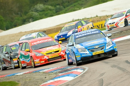 Thruxton, United Kingdom - May 1, 2011: Jason Plato leading the pack to victory in the British Touring Car Championships on May 1, 2011 at Thruxton, UK Stock Photo - 9489087