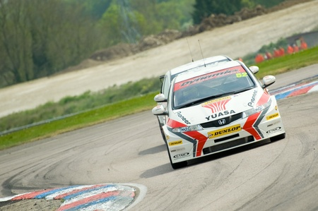 toca: Thruxton, United Kingdom - May 1, 2011: Honda Racing driver Gordon Shedden with team-mate Matt Neal in his slipstream at the British Touring Car Championships on May 1, 2011 at Thruxton, UK Editorial