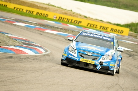 toca: Thruxton, United Kingdom - May 1, 2011: Jason Plato on the last corner before victory in the British Touring Car Championships on May 1, 2011 in Thruxton, UK. Editorial