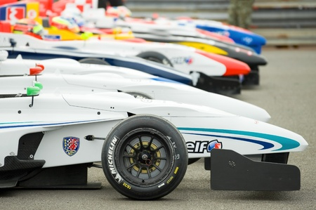 Thruxton, United Kingdom - May 1, 2011: Line of race cars in the Park Firme paddock during the Formula Renault Championships on May 1, 2011 in Thruxton, UK.