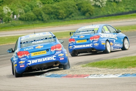 teammate: Thruxton, United Kingdom - May 1, 2011: Alex MacDowell leading Silverline Chevrolet team-mate Jason Plato through the complex during the British Touring Car Championships on May 1, 2011 in Thruxton, UK. Editorial