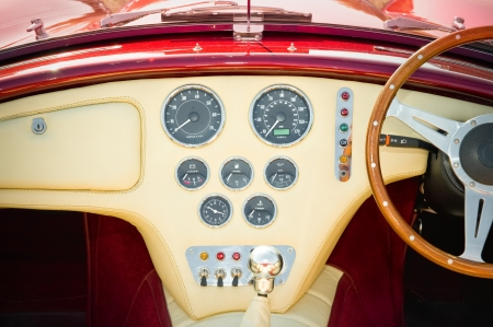 interior and dashboard detail of a restored retro soft-top sports car photo