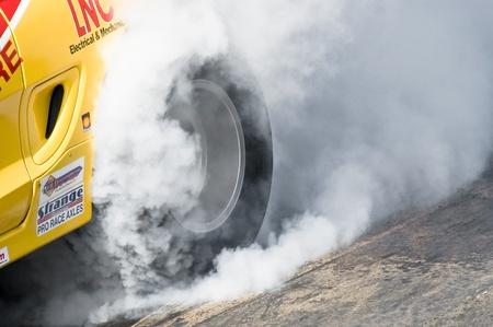 Santa Pod Raceway, UK - April 23, 2010: Closeup of a dragster tire burnout at the Big Bang Camper and Bus Festival at Santa Pod Raceway, UK Editorial