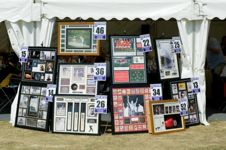 Eversley, UK - June 3, 2011: Collection of sporting and other celebrity memorabilia in a silent auction at a charity event in Eversley, UK