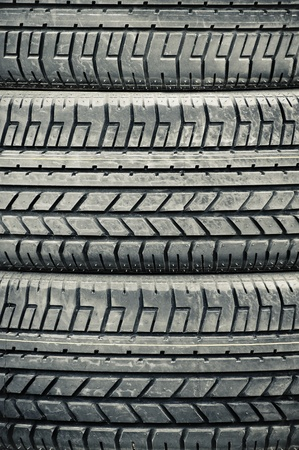 tyre tread: high contrast heavy duty vehicle tires closeup