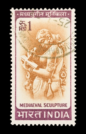 One rupee mail stamp printed in India featuring a medieval sculpture from the Parshwanath Jain Temple of Khajuraho, circa 1966 Stock Photo - 10073065