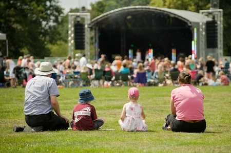 Yateley, UK - July 2, 2011: Family of four attending the Gig On The Green summer music festival in Yateley, UK. Stock Photo - 10592589