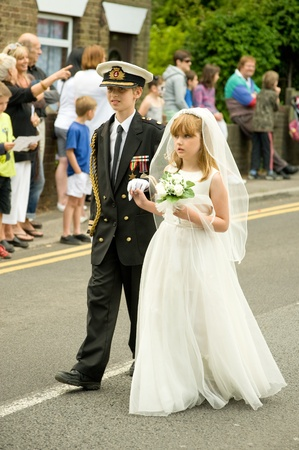 procession: Upper Hale, UK  - July 2, 2011: Children in a carnival procession dressed as the Royal Wedding couple of Prince William and Kate Middleton.