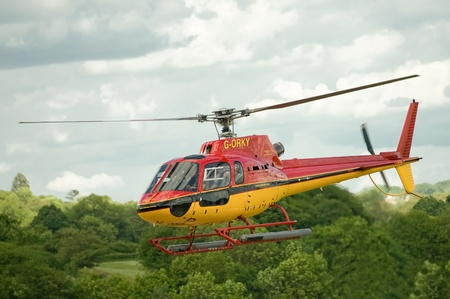 ferrying: London, United Kingdom - May 14, 2011: The popular GORKY tourist helicopter ferrying passengers over the lush countryside surrounding the city of London, UK