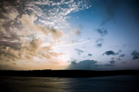 sunsets: full spectrum of colors at sunset over the coastline on cornwall, uk