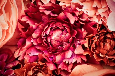 artificial flowers: abstract of colorful silk flowers in pink, red and orange