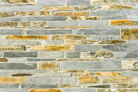 background abstracts: stone wall background of slate and sandstone masonry