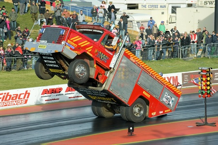 Santa Pod Raceway, UK - Oct 29, 2011: Backdraft Wheelie Truck demonstration at the Flame and Thunder race event. Stock Photo - 11100433