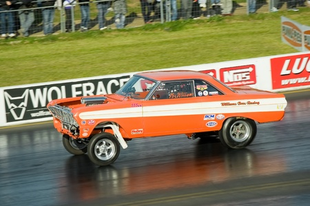 Santa Pod Raceway, UK - Oct 29, 2011:  Pro modified Ford Falcon hotrod at the Flame and Thunder race event.