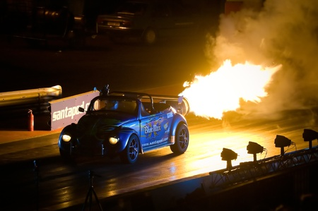 Santa Pod Raceway, UK - Oct 29, 2011: Burnout by jet powered Blue Max VW Beetle at the Flame and Thunder drag racing event.