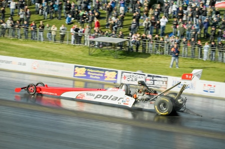 susi: Santa Pod Raceway, UK - Oct  29, 2011: Wheelspin during a high speed run by the 300mph Susi Polar top fuel dragster at the Flame and Thunder event.