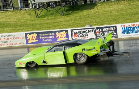 wheelspin: Santa Pod Raceway, UK - Oct  29, 2011: Sleek Plymouth Superbird Pro Mod funny car on the strip at the Flame and Thunder drag-racing event.