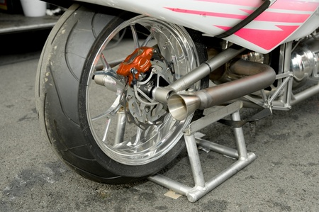 world record: Santa Pod Raceway, UK - Oct 29, 2011: Rear wheel detail of the world record breaking 280mph rocket motorcycle owned by Eric Leboul.