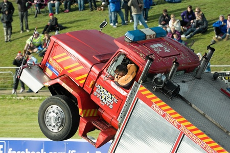 raceway: Santa Pod Raceway, UK - Oct 29, 2011: Stunt driving demonstration in a wheelie truck at the Flame and Thunder drag-racing event. Editorial