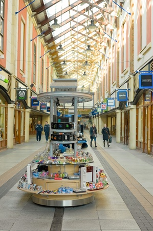 Portsmouth, UK - February 1, 2012: Watches and trinkets stall during quiet, post-christmas shopping at Gunwharfs Quay retail mall.