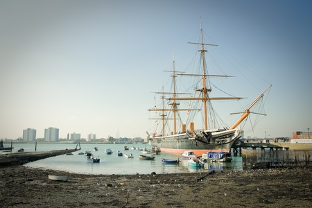 portsmouth: Portsmouth, UK - February 1, 2012: HMS Warrior, the first iron-clad battleship launched by the British Royal in 1860. It is now a museum ship and moored in the historic Naval docks of Portsmouth, UK Editorial