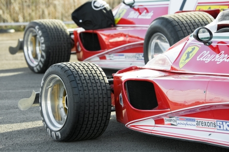 formula one: Blackbushe, UK - March 5, 2012: Vintage Ferrari Formula 1 cars on the film set of Rush, a movie directed by Oscar winner Ron Howard,