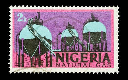 Mail stamp printed in Nigeria featuring natural gas storage tanks, circa 1973