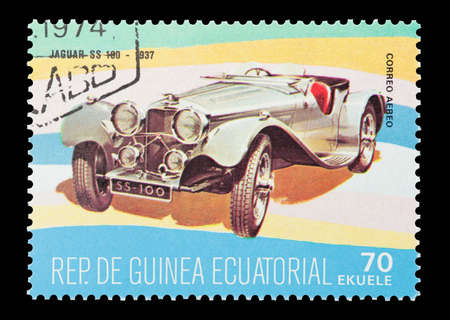 ss: Equatorial Guinea - circa 1974: Commemorative mail stamp printed in Equatorial Guinea featuring a vintage 1937 Jaguar SS 100 sports car.